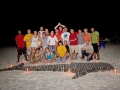Beach-barbeque-dinner-group-photo-Carpe-Vita-Explorer-Maldives-Explorer-Ventures-Liveaboard-Diving